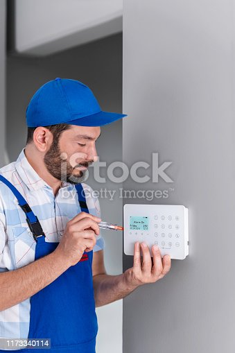 475693130 istock photo Security System Installing - Burglar Alarm Installing 1173340114