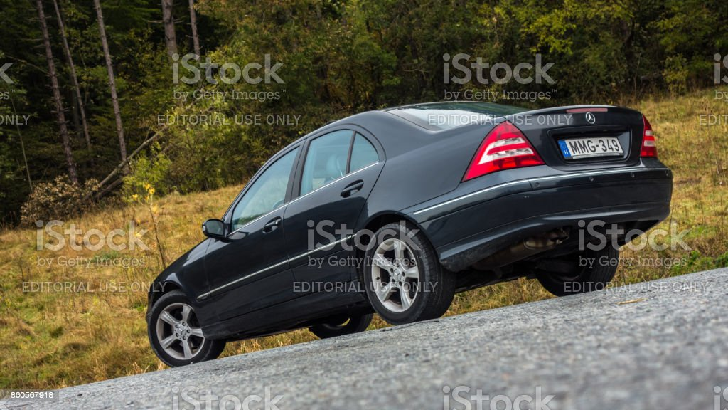 Sedan german car with chromed elements, alloy wheels, tinted windows Cluj Napoca/Romania - Octomber 09, 2017: Mercedes Benz C Class, model W203 - year 2005, Avantgarde equipment, Alloy wheels, Leather interior, sunroof. Parked on the side of the road Abdominal Muscle Stock Photo