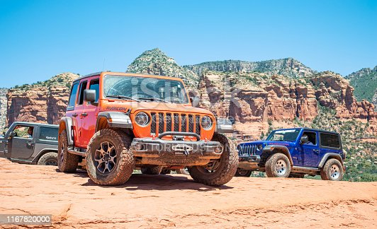 Sedona Arizona USA. May 25, 2019. 4X4 jeep cars drive off road. Red orange desert  landscape, clear blue sky, sunny spring day
