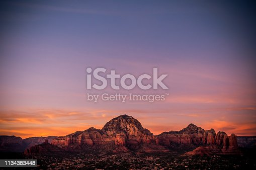 Sedona mountains in Arizona, USA. View of Capitol Butte, also known as Thunder Mountain, from Airport Mesa at sunset.