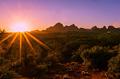Landscape of Sedona with Sunset and sun star burst