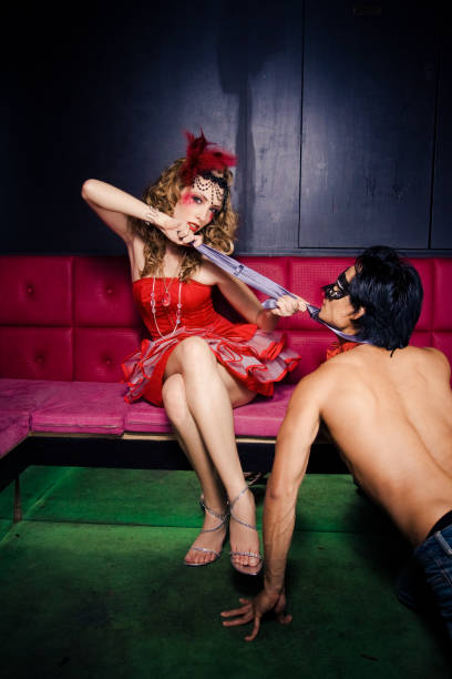 seduction - man dominating woman stock photos and pictures