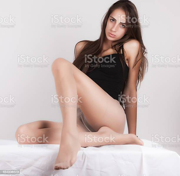 Attractive young girl posing at home