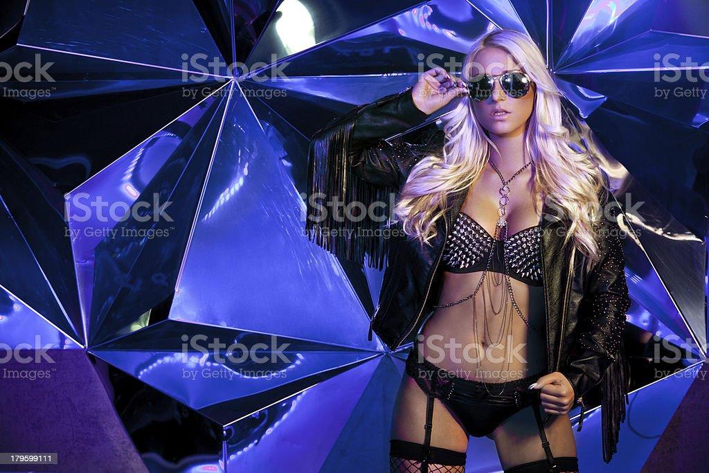 Seductive blonde wearing sexy underwear in a nightclub royalty-free stock photo