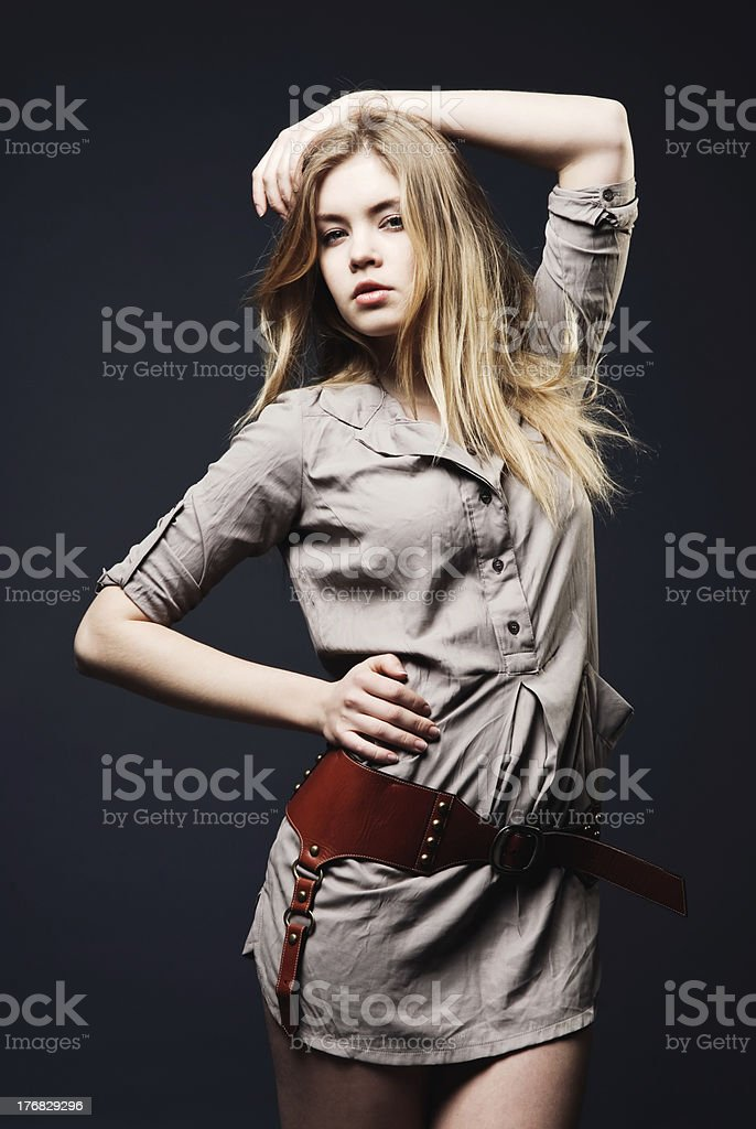 Seductive fashion portrait of young woman on dark background royalty-free stock photo