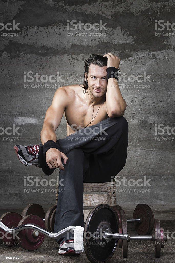 Seductive fit man smiling royalty-free stock photo