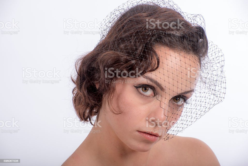 Seductive look from young woman wearing veil royalty-free stock photo