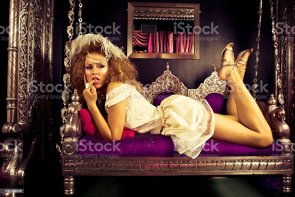 Seductive woman posing on sofa royalty-free stock photo