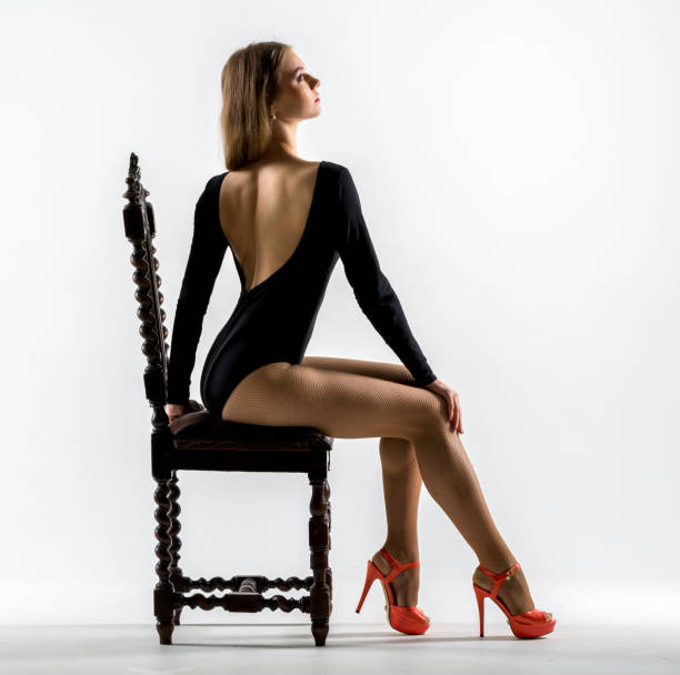 seductive woman sitting on chair - leotard stock pictures, royalty-free photos & images