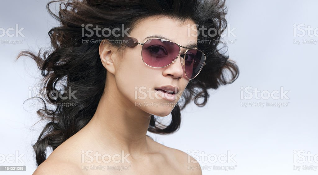 seductive young woman wearing sunglasses stock photo