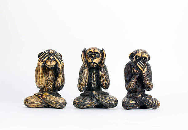 See, Hear, Speak No Evil, Carved Monkies Old proverb carved out in three small monkeys - shot against a white background. hear no evil stock pictures, royalty-free photos & images
