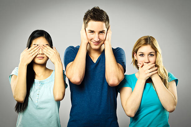See, hear, speak Buddhist monkey concept hands covering ears hear no evil teenage girls women stock pictures, royalty-free photos & images