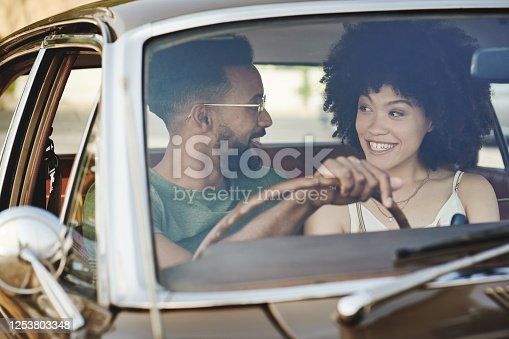 Shot of a young couple going a road trip together