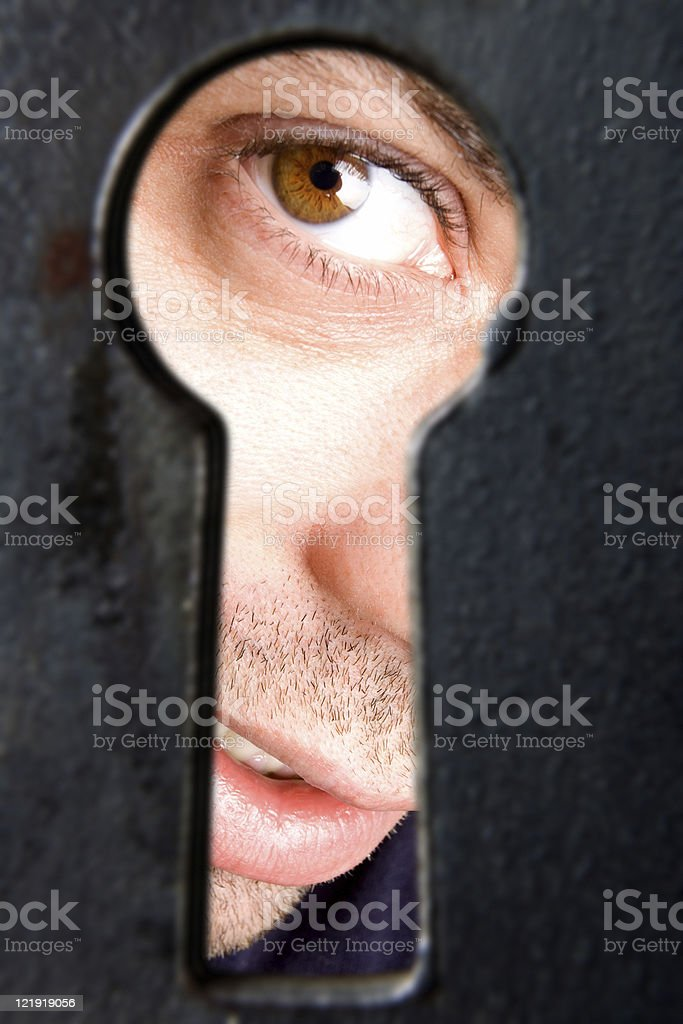 I see you! - man looking through keyhole royalty-free stock photo
