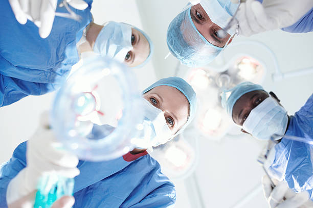 See you on the other side Patient's view of medical surgeons and doctors putting a patient under a general anaesthetic anesthetize stock pictures, royalty-free photos & images