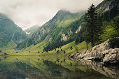 Mountains reflecting on the seealpsee in Switzerland