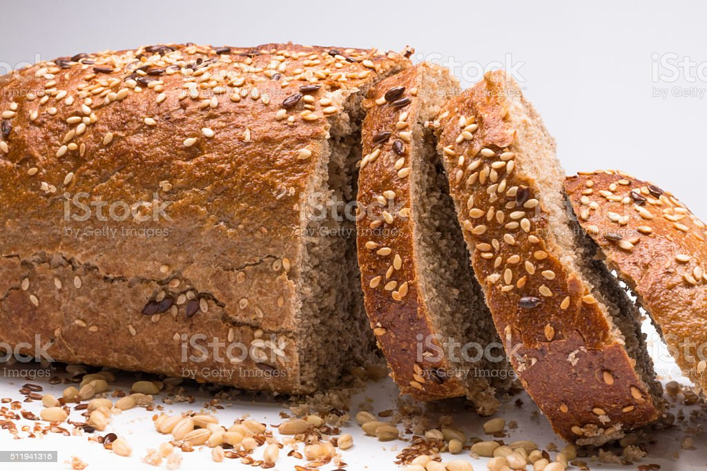 seed bread, a slice cut on white background stock photo