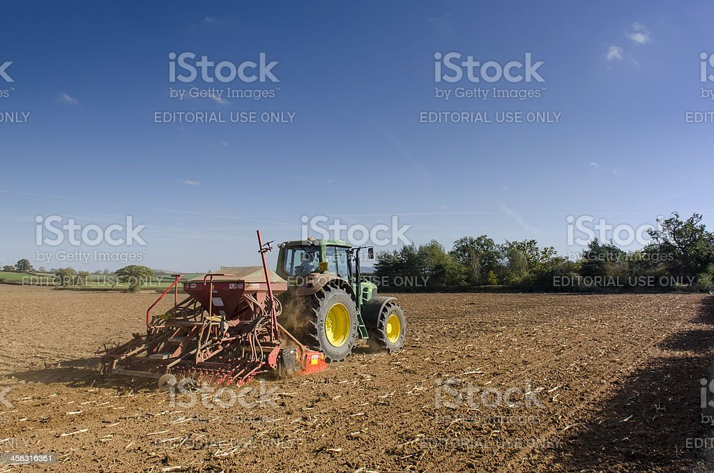 Seed drilling, tractor planting crops stock photo
