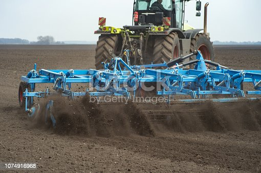 seedbed cultivator working in farm field