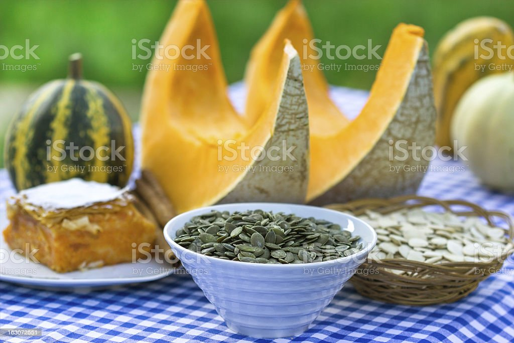 Seeds, cake and slices of pumpkin royalty-free stock photo