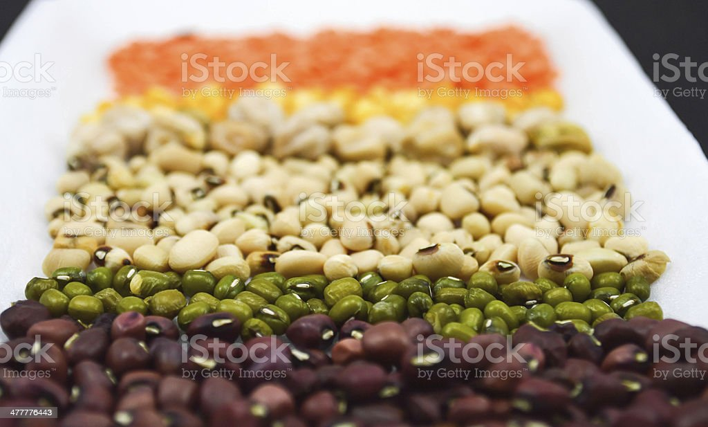seeds, grains on white plate in black background close up royalty-free stock photo