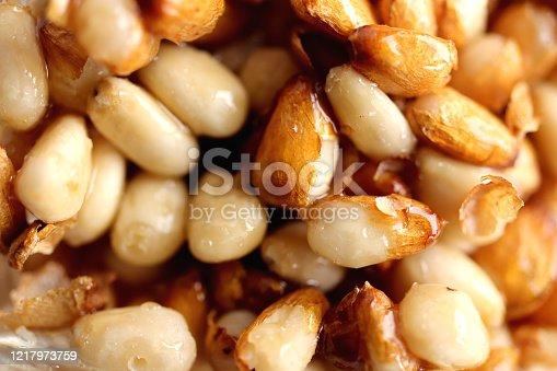 Seeds of cedar cones in honey. Filling background.