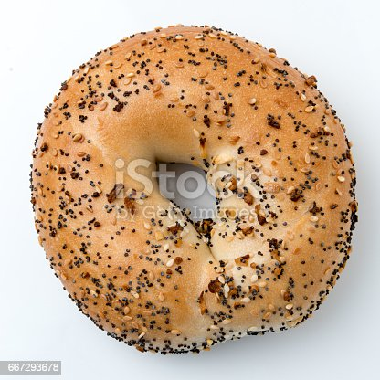 seven seeds organic Bagel on white background