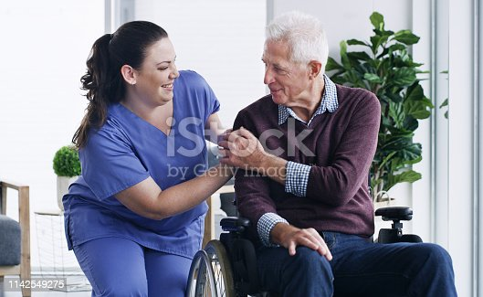 Shot of a senior man in a wheelchair being cared for a nurse