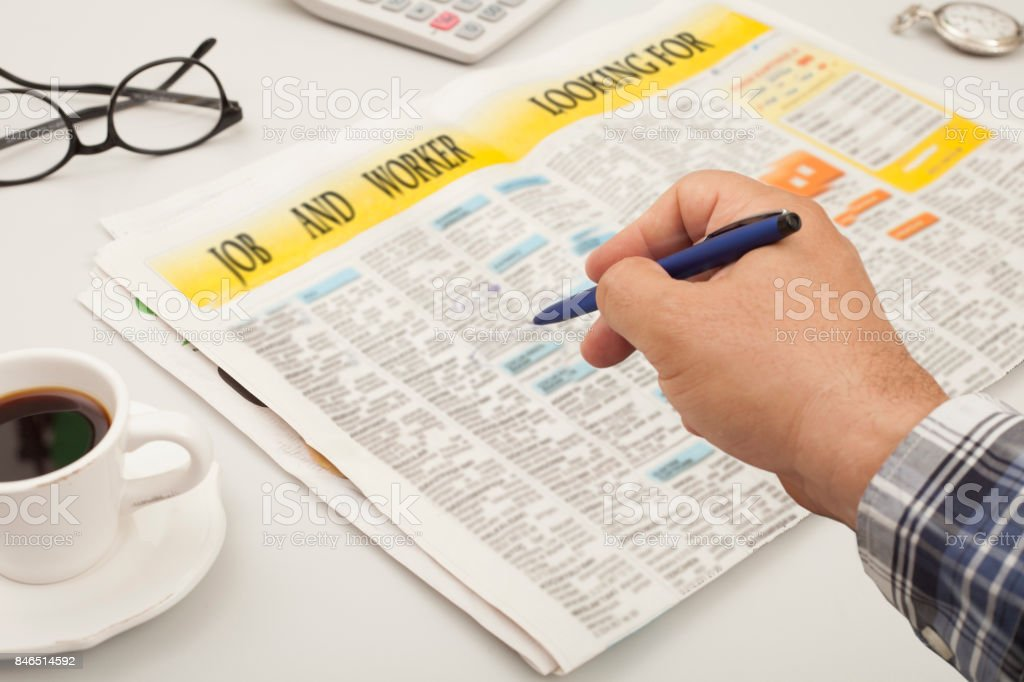 seeking for job at newpaper stock photo