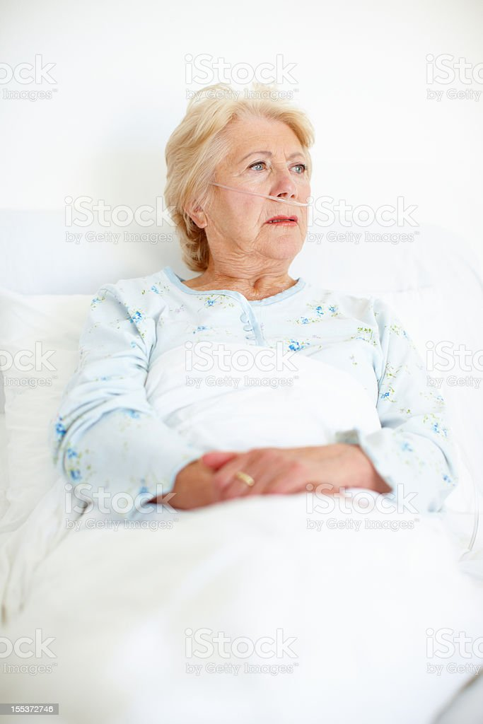 Seeking the resolve to fight her illness - Senior Health royalty-free stock photo
