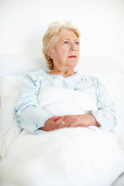 Seeking the resolve to fight her illness - Senior Health Ailing senior woman looks away as she contemplates her illness - Copyspace oxygen tube stock pictures, royalty-free photos & images
