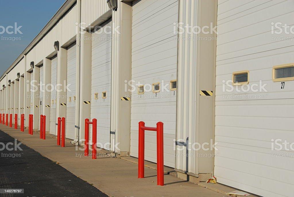 Seemingly endless array of white garage doors royalty-free stock photo