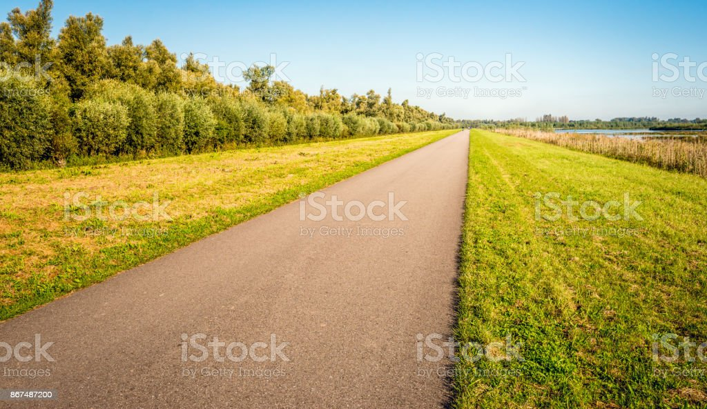 Seemingly endless country road in a Dutch polder stock photo