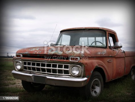 An old, deserted pickup truck on a dreary day