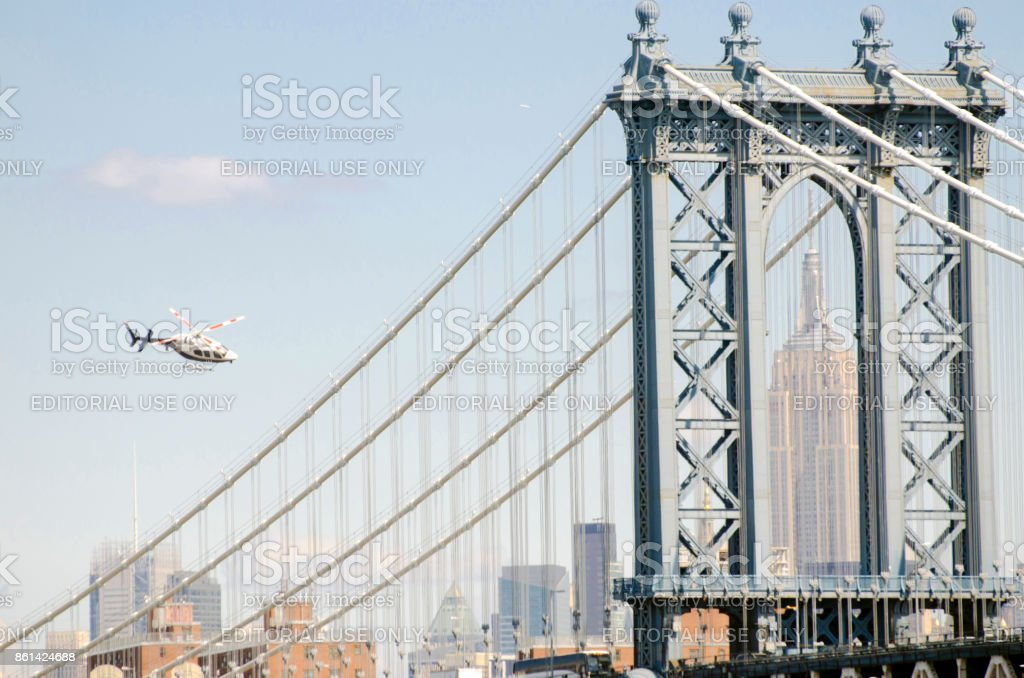 Seen from the Brooklyn Bridge, the Empire State Building is framed in a tower of the 59th Street Bridge. stock photo