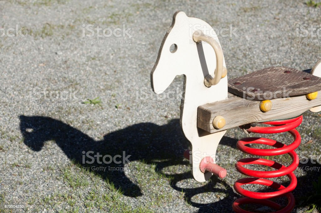 Seesaw, children outdoors playground toy. stock photo
