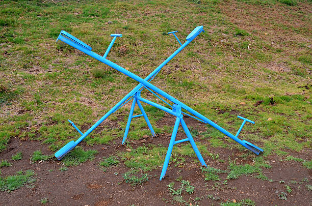 Seesaw or Teetertotter stock photo