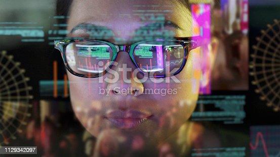 1129342100 istock photo See-thru data screen watcher. 1129342097