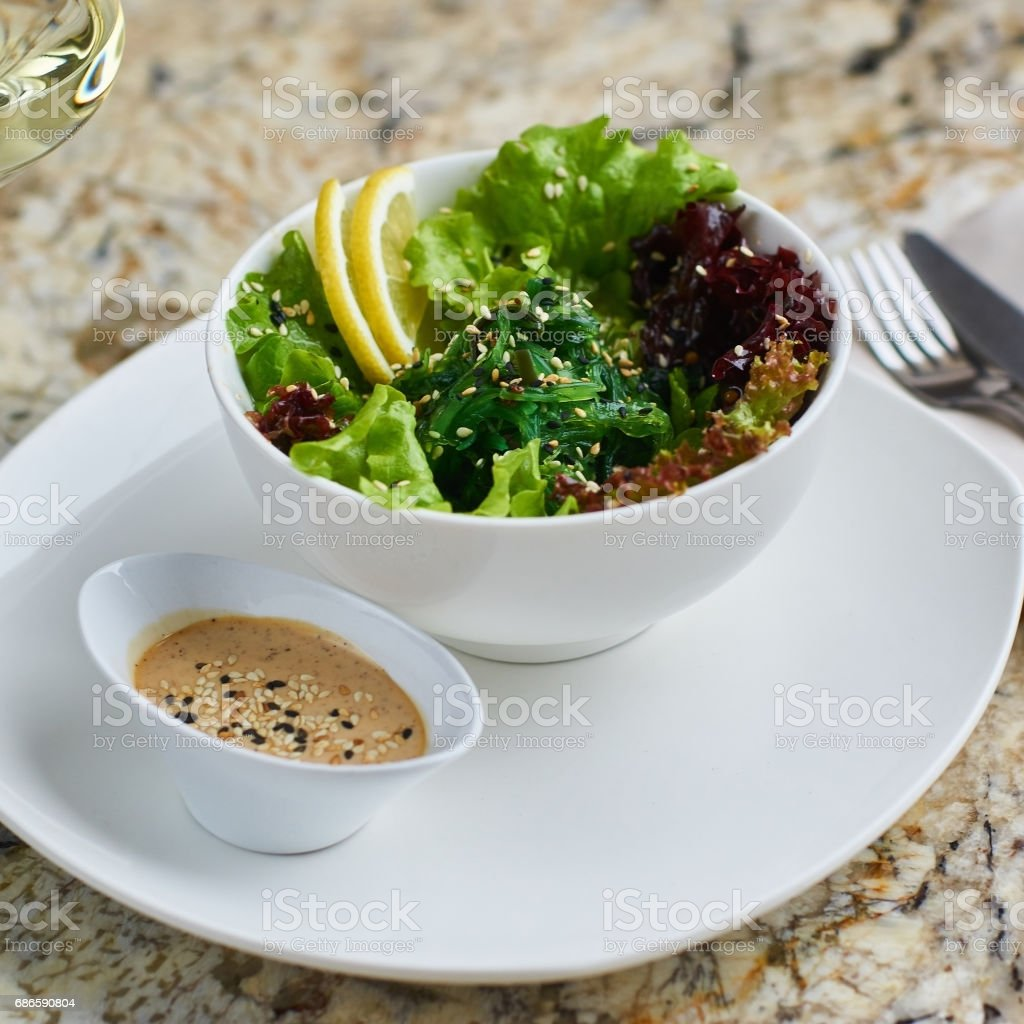 Seeweed salad in white bowl royalty-free stock photo
