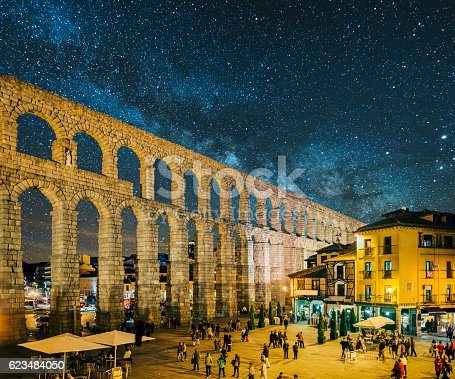 The roman aqueduct in Segovia, Spain, under a starry sky
