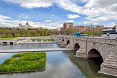 View of famous Segovia bridge over Manzanares river in downtown Madrid, Spain.