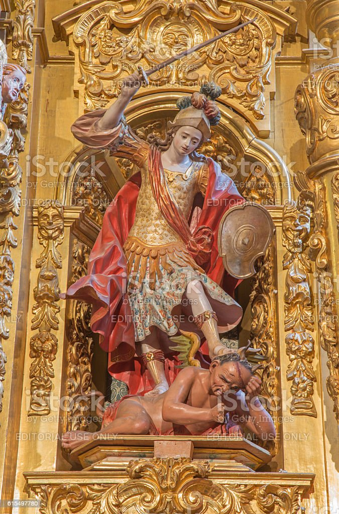 Segovia - polychrome baroque statue of archangel Michael stock photo