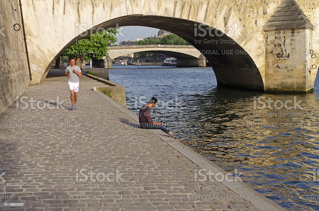 Seine embankment in early summer evening. stock photo