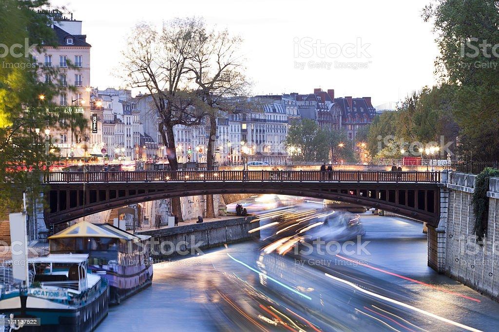Seine River with Illuminated Boats Cruising  at Dusk, Paris, France stock photo