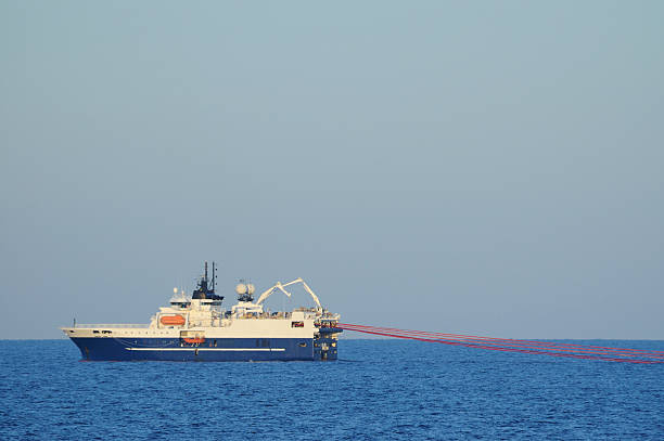 Seismic survey ship towing streamers