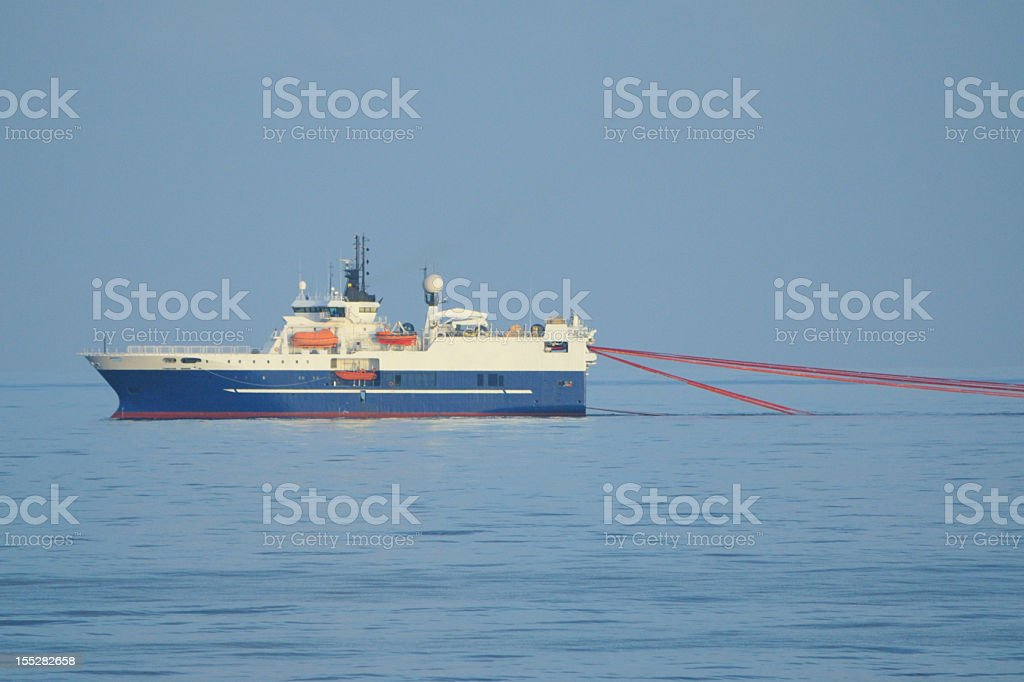 Seismic Survey Ship with streamers stock photo