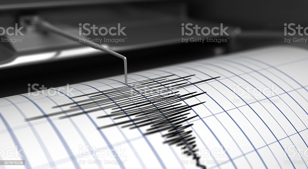 Seismograph and earthquake stock photo
