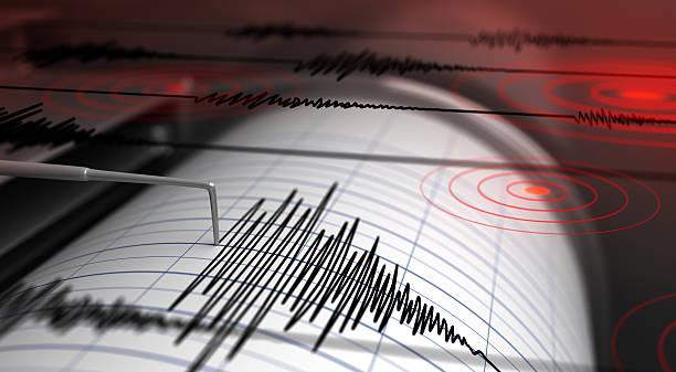 Seismograph and earthquake stock photo