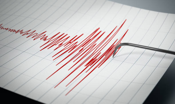 Seismograph recording the seismic activity of an earthquake Seismograph recording the seismic activity of an earthquake. analogue audio storage media stock pictures, royalty-free photos & images