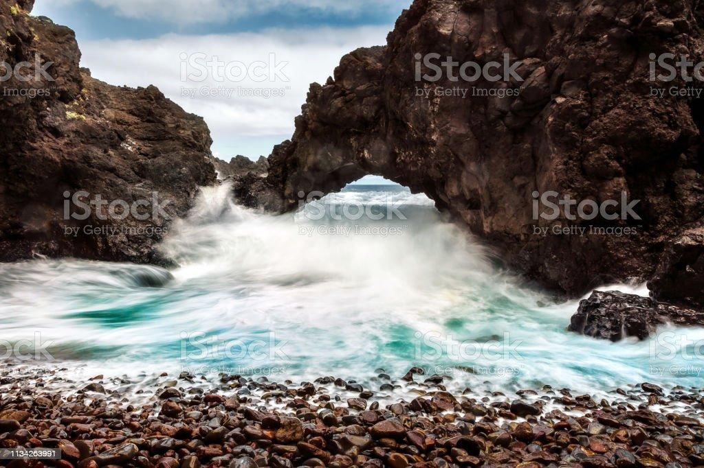 Seixal Madeira waves through the arch stock photo